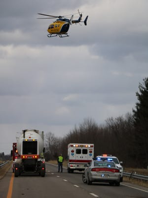 A helicopter takes off with a patient after a serious injury crash between an Amish buggy and an SUV, on U.S. 42 near the Ashland-Wayne County line, late Friday afternoon.