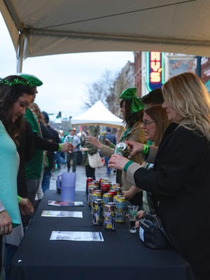 Attendees of a previous Main Street Brewfest line up at one of the many tasting stations.