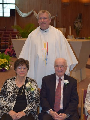 Bob and Arlene Sills, who've been married 65 years, with Father Kevin Thomas of St. Aidan Catholic Church.