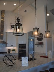 Light fixtures in the shape of horse hooves with a