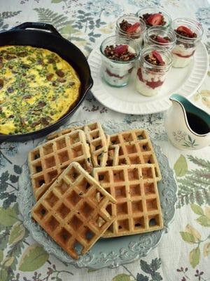 Buckwheat blueberry waffles, pea and chive frittata and strawberry rhubarb yogurt parfaits make a scrumptious breakfast for dinner menu.