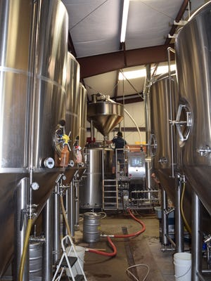 Wildcard brewer Andy Crocker tends to a red ale he brewed in collaboration with Woody's Brewing for Redding Beer Week in 2016.