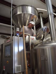 Scott Wlodarczyk, one of the founders of Woody's Brewing Co., adds some bittering hops to a collaboration with Wildcard Brewing. The Eastside Westside Red IPA was featured during last year's Redding Beer Week.