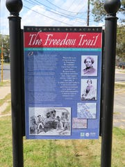 A sign on the Syracuse Freedom Trail shares information