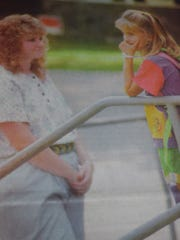 Meghan Elder talked with one of her teachers, Carla Patterson as she waited for her mom in August of 1995.