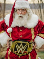 Mick Foley former WWE fighter in a Santa Claus costume.