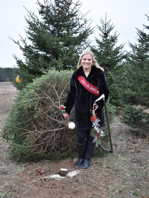 70th Alice in Dairyland Crystal Siemers-Peterman is all smiles after cutting down a white spruce, officially kicking off the 2017 Christmas tree season during a ceremony at Ginter Farms in Adams County on Nov. 14.