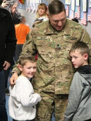 Noah and Damian Rickey were greeted with a holiday homecoming when their father, Spc. Marz Rickey, who was deployed with the U.S. Army overseas, returned and surprised them at Bataan Memorial Primary School on Thursday.