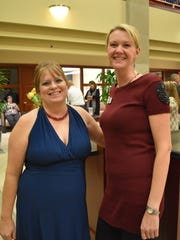 As part of the Annual Holiday Wine Event, Fox Valley Savings Bank and Cujak's Wine & Coffee Bar work together to raise more than $4,000 for local non-profits. Pictured are, from left: Sara Cujak and Kirsten Quam at the 2017 event.