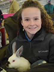 Lexi Cross, a sixth-grade student from Buckeye High School with the Rapides Parish 4-H, holds a rabbit she is showing at the Central District Livestock Show held Saturday at the Dewitt Livestock Facility.