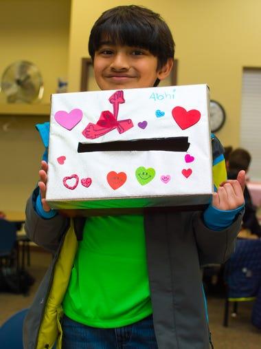 Abhinav Ganti, 8, of Waukee decorates a Valentine's