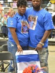 Charles and Tanya Davis of Mansfield stand by the empty