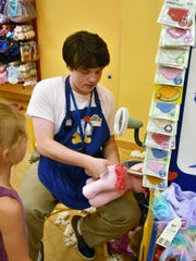 Build-A-Bear Workshop employee Skylar Hellmund stuffs
