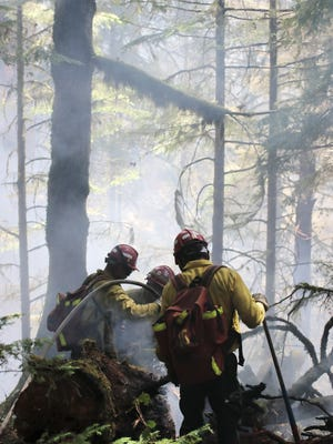 Firefighters battle a blaze at Silver Falls State Park.