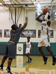 Peabody's Melvion Flanagan (3) launches a 3-pointer against Carencro High School Tuesday, Dec. 11, 2018.
