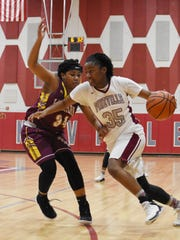 Pineville senior Indiya Smith (35) drives past a Natchitoches Central defender during a game last season.