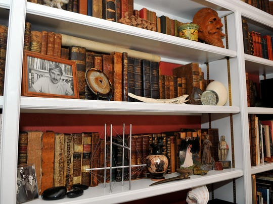 Vintage books line the shelves in the historic home of Bob and Jenifer Marx. Bob Marx, a renowned shipwreck and treasure hunter, died July 4.