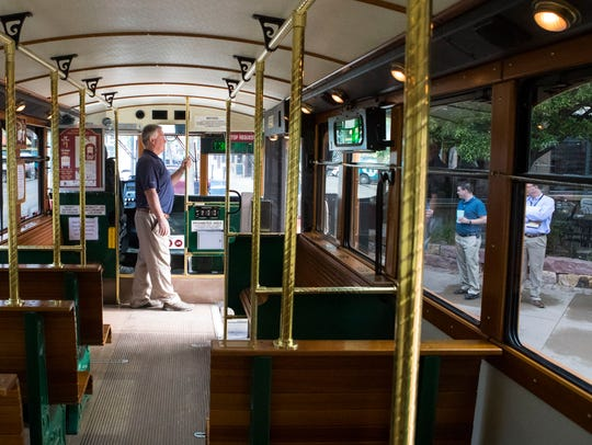 Tom Olson stands inside the trolley on Wednesday, May