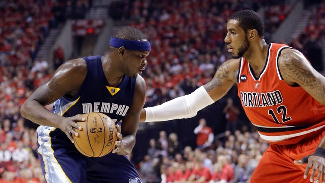 Memphis Grizzlies forward Zach Randolph, left, looks to drive against Portland Trail Blazers forward LaMarcus Aldridge during the first half of Game 3 of a first-round NBA basketball playoff series in Portland, Ore., Saturday, April 25, 2015.