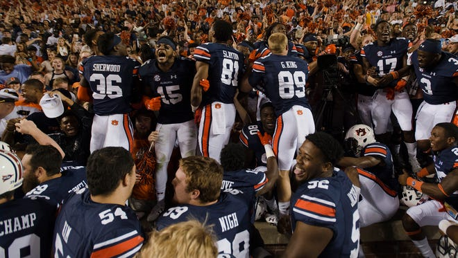 Auburn players celebrate with their fans after Auburn defeated LSU 18-13 as time expired in the NCAA football game between Auburn and LSU Saturday, Sept. 24, 2016, at Jordan Hare Stadium in Auburn, Ala.Albert Cesare / Advertiser
