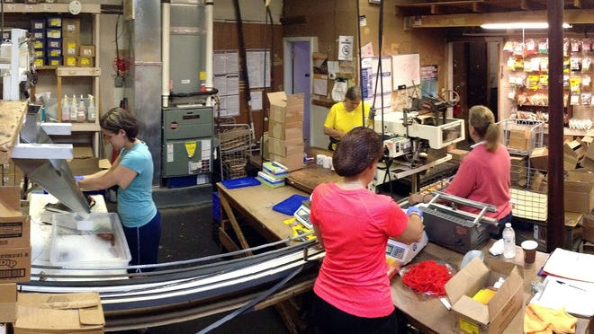 Women work in the packing room at the Rayge Candy Co. in Brick.