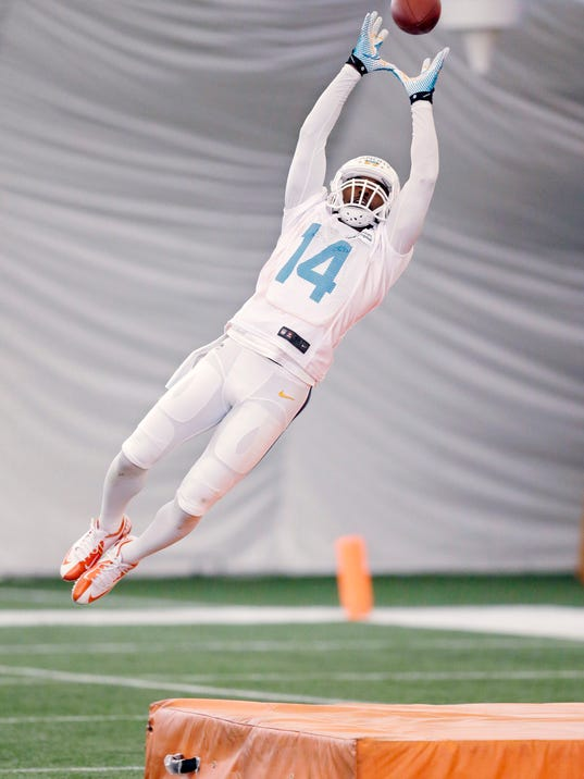 Miami Dolphins wide receiver Jarvis Landry leaps for a ball while running drills during NFL football minicamp, Tuesday, June 17, 2014, at the team's training facility in Davie, Fla. (AP Photo/Wilfredo Lee)
