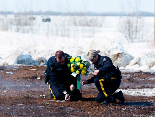 Members of the Royal Canadian Mounted Police lay flowers
