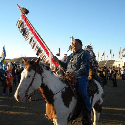 Tuffy First from the Fort Peck Indian Reservation carries