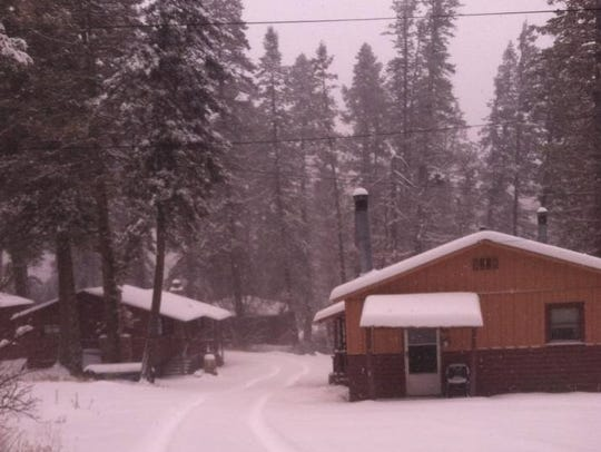 A view of the cabins during a snowy day at The Cabins