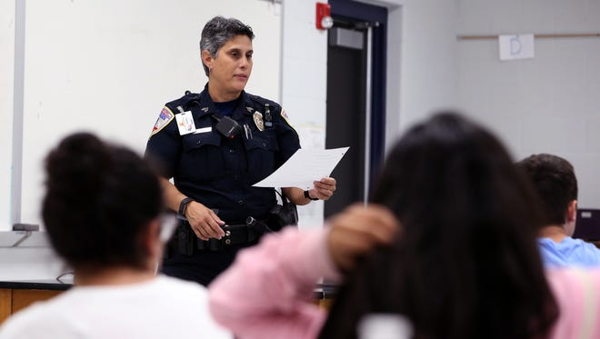 Corpus Christi Independent School District Police Sgt. Janelle Cantu talks with students at the Metro Elementary School of Design during the first meeting of a new bullying program she started at the school on March 27, 2017.