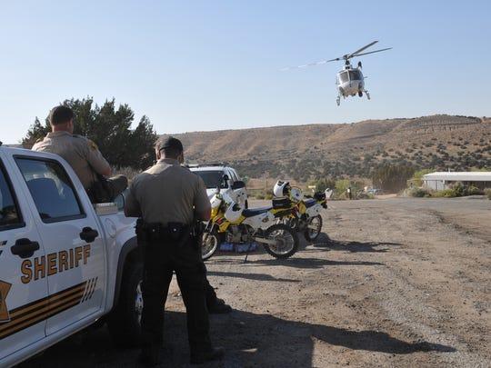 Law enforcement personnel search for a suspect who