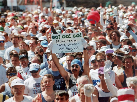In this photo, owned by Tony Sifuentes, Sifuentes is seen carrying a sign at the start of the 1996 Boston Marathon. The photo appeared in the following day's Boston Globe.