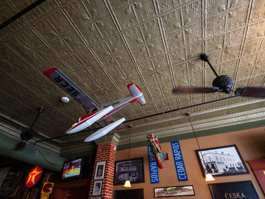 Airplanes hanging from the ceiling at Parlor City Pub