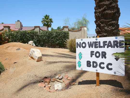 Many homeowners in Bermuda Dunes Country Club have placed signs in their yards in opposition to a proposed mandatory golf membership at the club, May 10, 2016.