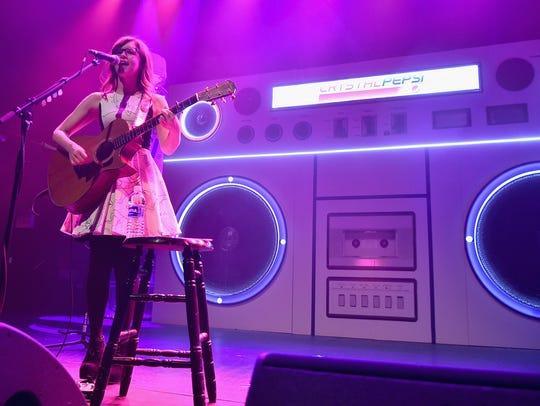 Singer Lisa Loeb performs onstage during Crystal Pepsi