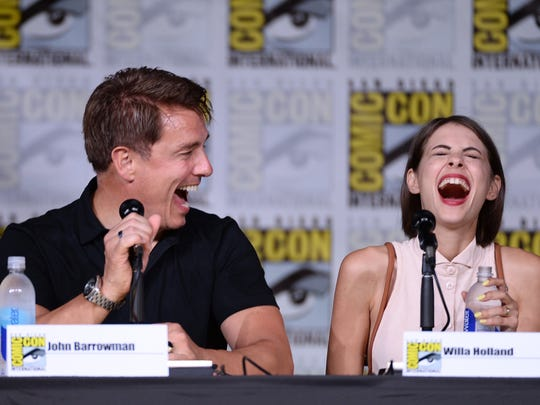"""Actor John Barrowman (L) and Willa Holland attend the """"Arrow"""" Special Video Presentation and Q&A during Comic-Con International 2016 at San Diego Convention Center on July 23, 2016."""