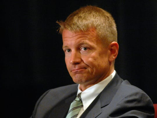 Blackwater CEO and founder Erik Prince listens during