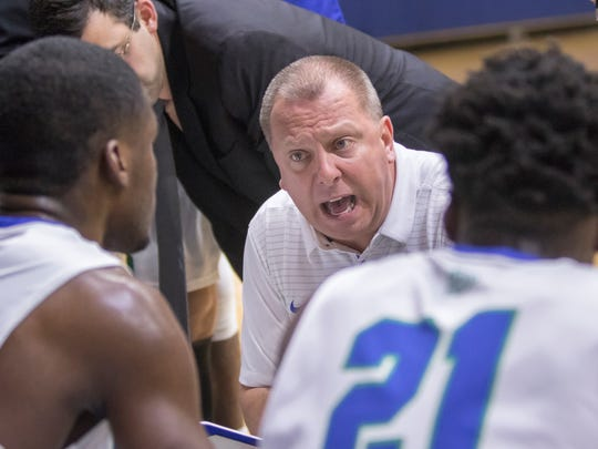 Head coach Jeff Burkhamer talks with his players during a timeout in the Montevallo vs UWF men's basketball game at the University of West Florida in Pensacola on Monday, December 18, 2017.