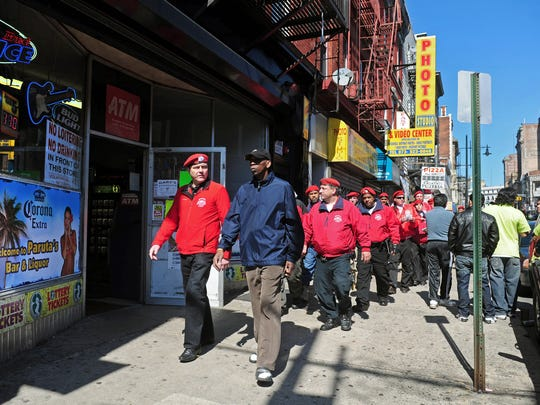 The Guardian Angels founder Curtis Sliwa and Mayor Jeffrey Jones, front L-R, lead the Angels down Market St.on April 17, 2011,  for their first patrol in Paterson on Sunday. The Guardian Angels,  in the city with the support of Mayor Jeffrey Jones,  will become an extra set of eyes and ears with the layoff of 125 Paterson Police officers.