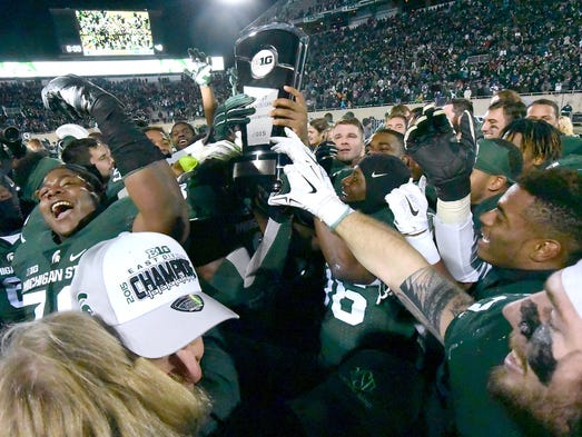 The Spartans celebrate with the Big Ten East Division