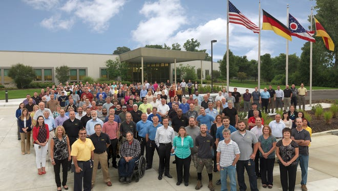 Vega employees outside of their headquarters in Oakley.