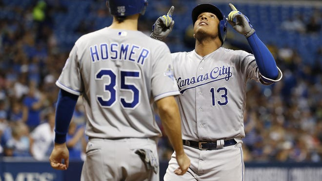 Kansas City Royals catcher Salvador Perez (13) is congratulated by first baseman Eric Hosmer (35) after he hit a 2-run home run during the seventh inning against the Tampa Bay Rays at Tropicana Field Tuesday night in St. Petersburg, Fla.