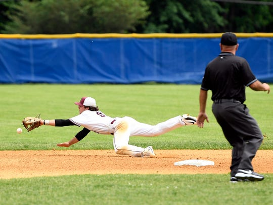 Don Bosco infielder Anthony Petrosino dives for a ball.