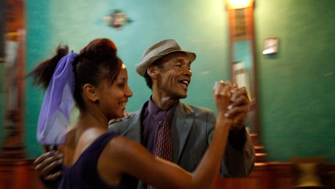 Performers dancing to live music at Casa de la Trova, house of troubadors, in Santiago de Cuba, Cuba, in 2012.  Music is an integral part of Cuban culture.