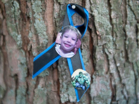 "A photo of 3-year-old Brendan Creato is attached to a tree in Cooper River Park in Haddon Township near where the body of Brendan Creato was found in October.  Brendan's father, David ""DJ"" Creato was indicted Monday for the murder of 3-year-old Brendan."
