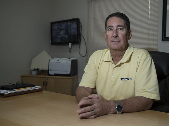 Executive Director of Arizona Interscholastic Association David Hines poses in his office on Monday, July 17, 2017 in Phoenix, Ariz.
