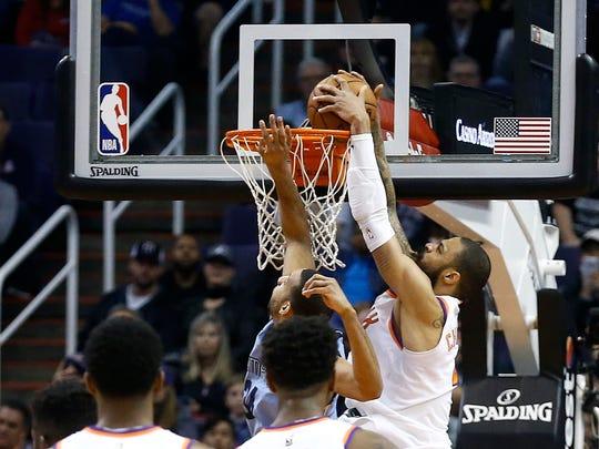 Suns center Tyson Chandler slams a buzzer-beating dunk against Grizzlies forward Brandan Wright to beat Memphis on Tuesday.