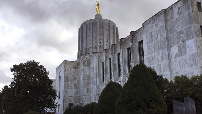 This Jan. 11, 2018, file photo shows dark clouds hovering over the Capitol in Salem.
