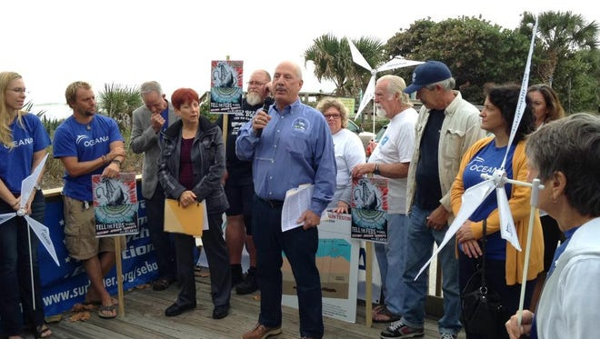 Mitchell Roffer, president of Roffer's Ocean Fishing Forecasting Service Inc., speaks Wednesday at Pelican Beach Park in Satellite Beach at an Oceana rally against offshore oil exploration and drilling along the Atlantic Outer Continental Shelf.