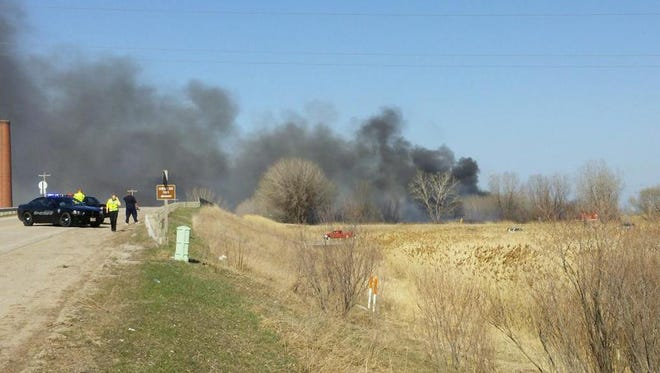 Firefighters tackle a grass fire at Ken Euers Nature Area on Green Bay's northwest side.